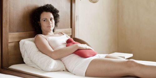 Болит живот перед месячними: возможние причини